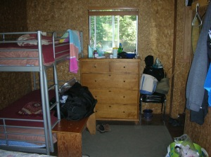 Bunk beds and door viewed from queen bed